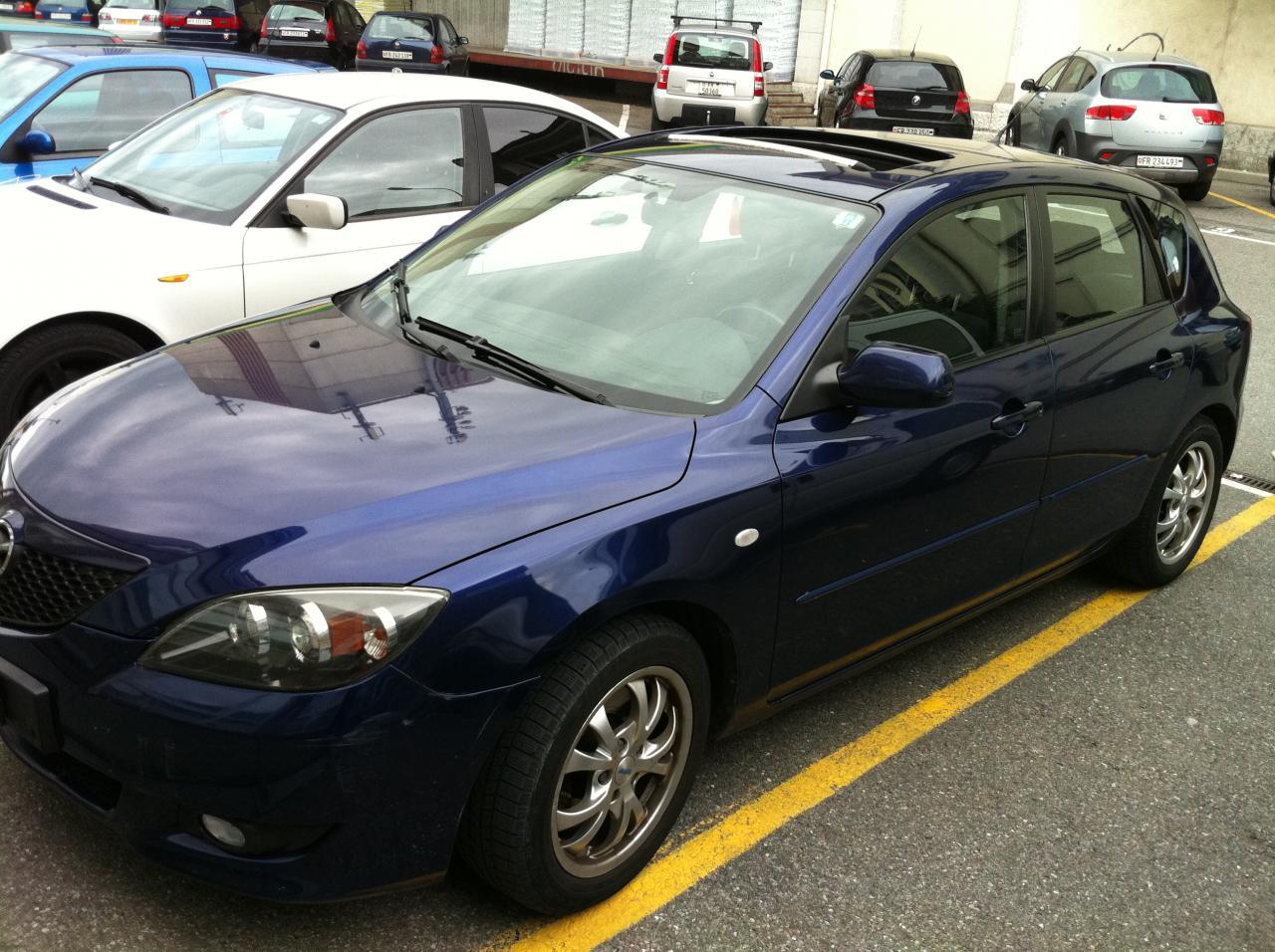Mazda 3. tout option année 2004